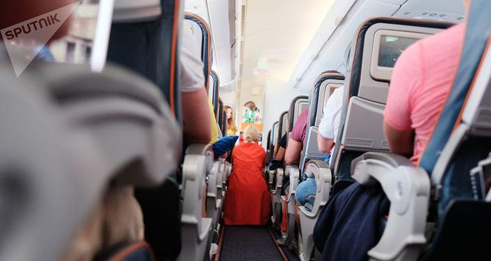 Les passagers d'un avion en vol