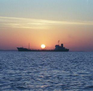 An Iranian water storage tanker sails off the coast of Qeshm Island 14 February 2001 in the Strait of Hormuz