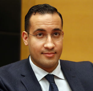 Former President Macron's security aide Alexandre Benalla appears before the French Senate Laws Commission prior to his hearing, in Paris Monday, Jan.21, 2019. Benalla has been taken into police custody last week in an investigation of possible misuse of diplomatic passports and then released. (AP Photo/Christophe Ena)