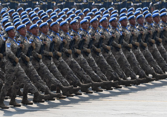 Chinese People's Liberation Army personnel participate in a military parade at Tiananmen Square in Beijing on October 1, 2019