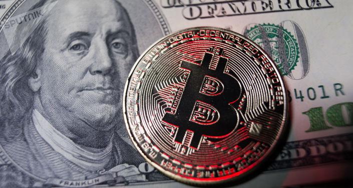 Vers un krach monétaire? «À terme, le Bitcoin et l'or vont gagner contre la monnaie papier» - Sputnik France