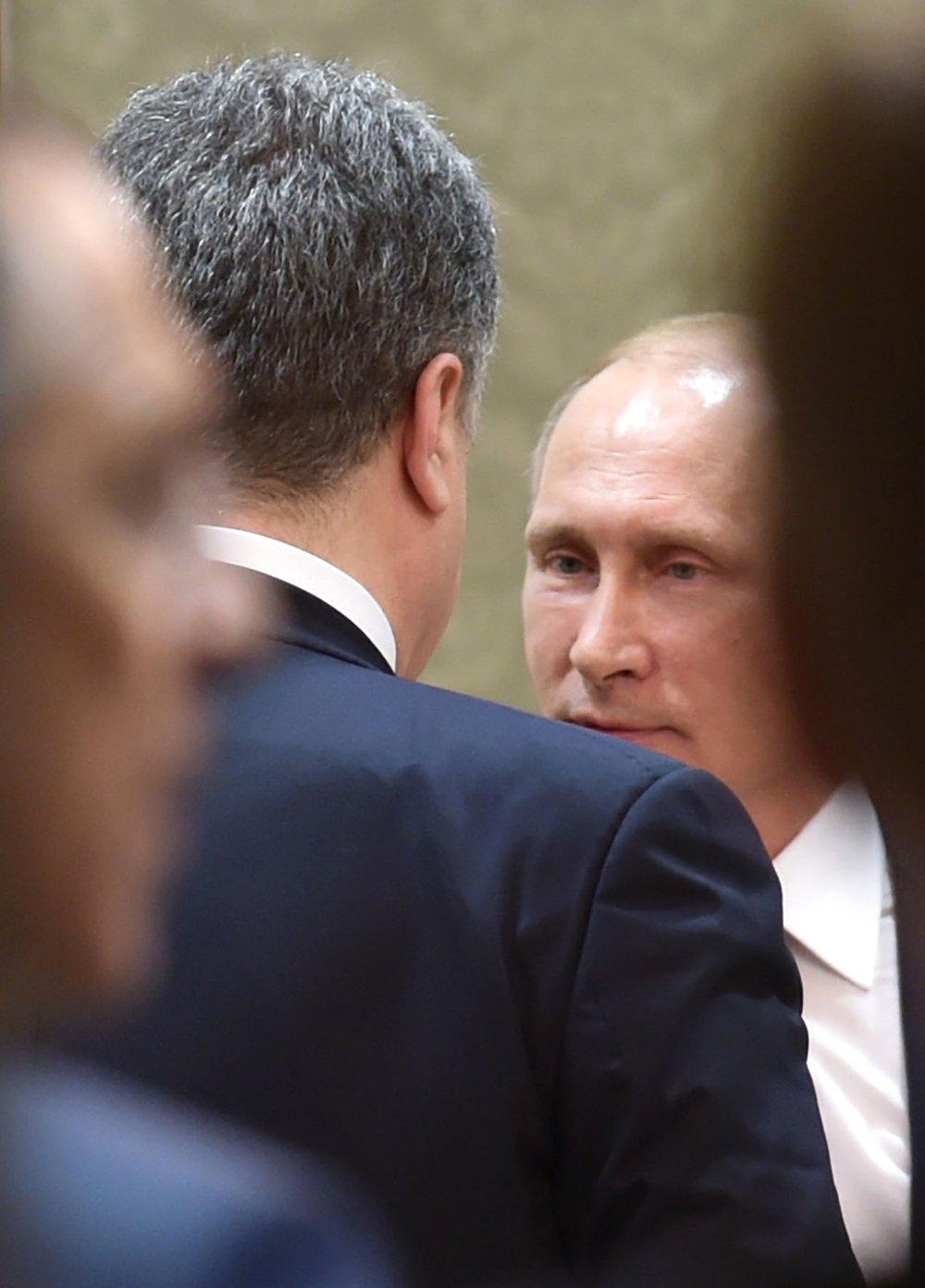 Le président russe Vladimir Poutine et le ukrainien Piotr Porochenko à Minsk