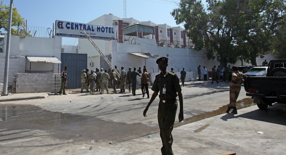 Somali security forces gather outside the scene of a twin bombing attack on a hotel in the capital Mogadishu Somalia Friday Feb. 20 2015
