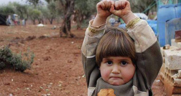 La photo d'une fillette syrienne, prise par le journaliste Osman Sagirli dans un camp de réfugiés syriens en Turquie
