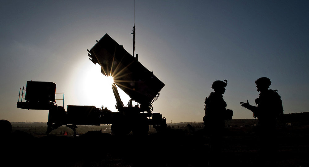 U.S. Soldiers with the 3rd Battalion, 2nd Air Defense Artillery Regiment talk after a routine inspection of a Patriot missile battery at a Turkish military base in Gaziantep, Turkey, Feb. 26, 2013.