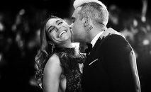 British singer Robbie Williams (R) kisses his wife Ayda Field as they arrive for the screening of the film The Sea of Trees at the 68th Cannes Film Festival in Cannes, southeastern France, on May 16, 2015