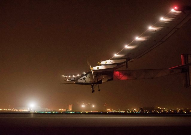 Solar Impulse 2 descends to land in Muscat March 9, 2015. Two pilots attempting the first flight around the world in a solar-powered plane began the maiden leg of their voyage on Monday, the mission's official website said. Solar Impulse 2 took off from Abu Dhabi in the United Arab Emirates en route to the Omani capital Muscat at the start of a five-month journey of 35,000 km (22,000 miles) organised to focus the world's attention on sustainable energy.