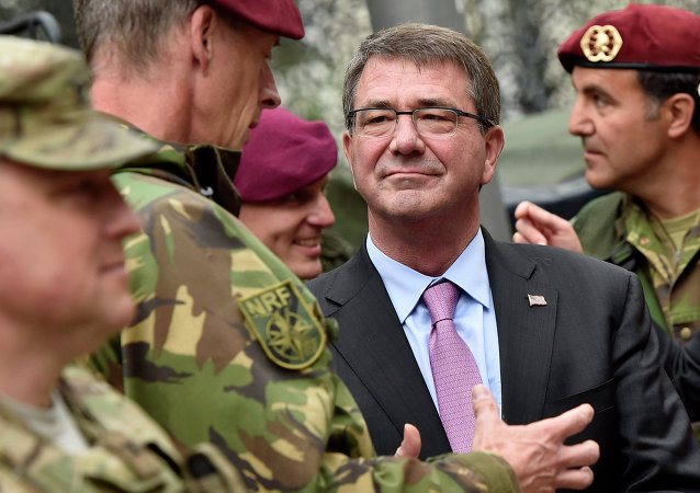 US Secretary of Defense Ash Carter, right, listens to NATO Response Force soldiers during his visit to Germany.
