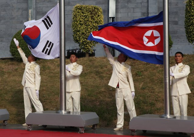 Drapeaux nord-coréen et sud-coréen