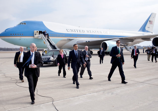 President Barack Obama with U.S. Representative Mary Jo Kilroy (right) and Senator Sherrod Brown (left, behind secret service agent) arriving at Port Columbus in 2009