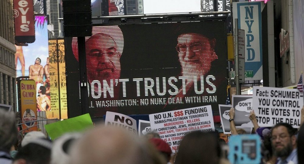 An image of Iranian leaders is projected on a giant screen in front of demonstrators during a rally apposing the nuclear deal with Iran in Times Square in the Manhattan borough of New York City