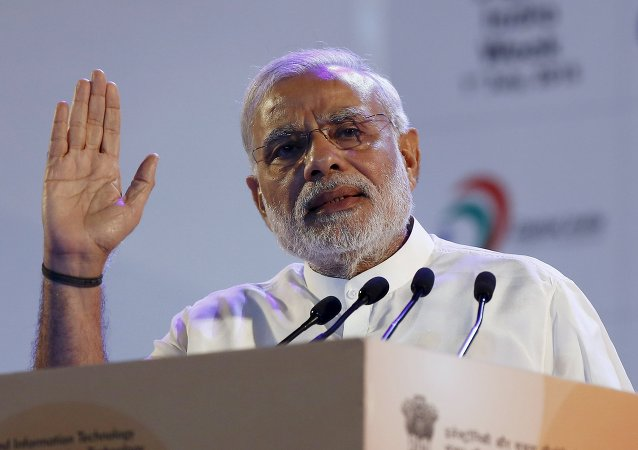 Indian Prime Minister Narendra Modi gestures while addressing the gathering during the launch of Digital India Week in New Delhi, India, July 1, 2015.