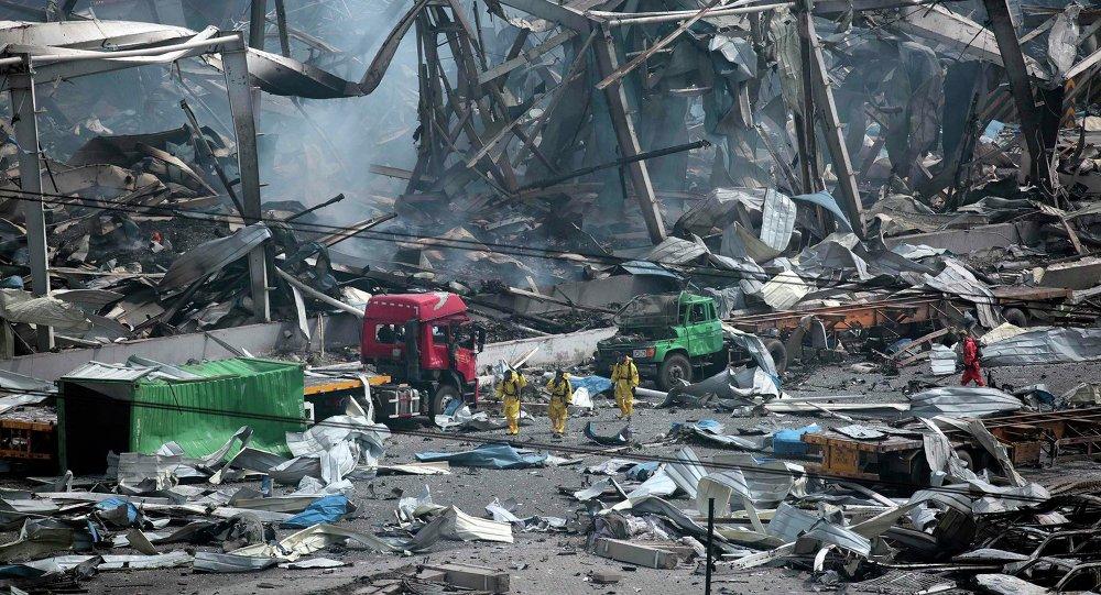 Sur les lieux des explosions à Tianjin