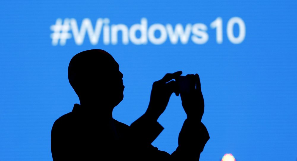 A Microsoft delegate takes a picture during the launch of the Windows 10 operating system in Kenya's capital Nairobi, July 29, 2015