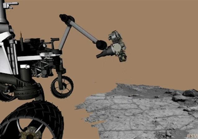 Le robot Curiosity fore une roche sur Mars. Reconstitution animée