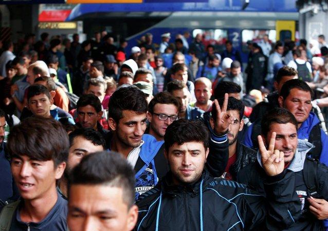 Des migrants à la gare de Munich, le 13 septembre 2015