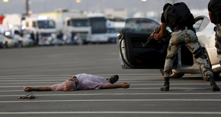 A member of Saudi security forces is seen during a mock encounter scene during a military parade in preparation for the annual Haj pilgrimage in the holy city of Mecca September 17, 2015