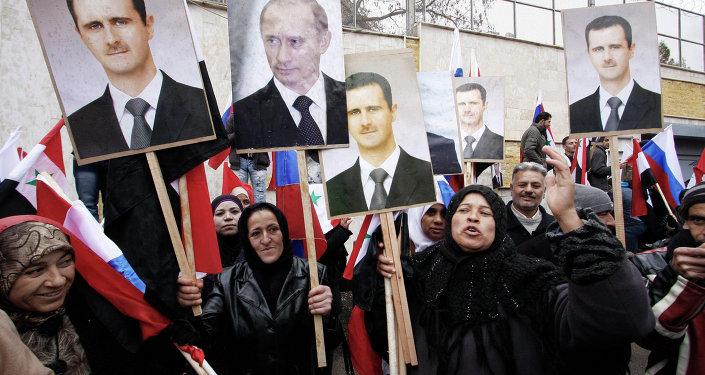 Manifestants avec les portraits du président Bachar el-Assad et président Vladimir Poutine, Damas. Archive photo