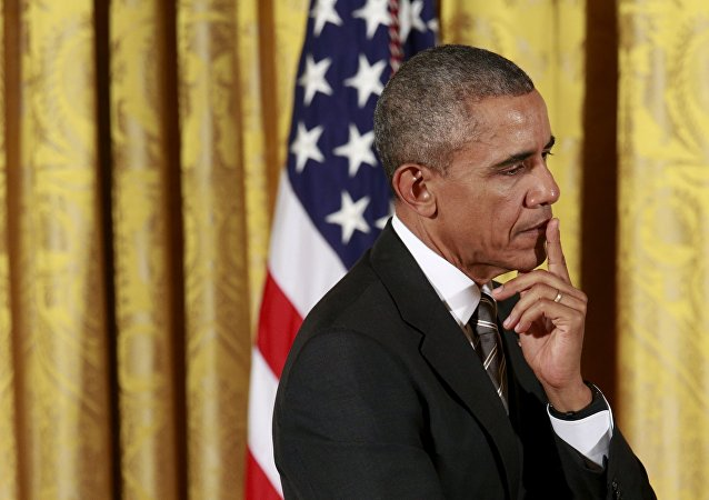 U.S. President Barack Obama listens as he is introduced to speak at the White House Summit on Worker Voice in Washington October 7, 2015.