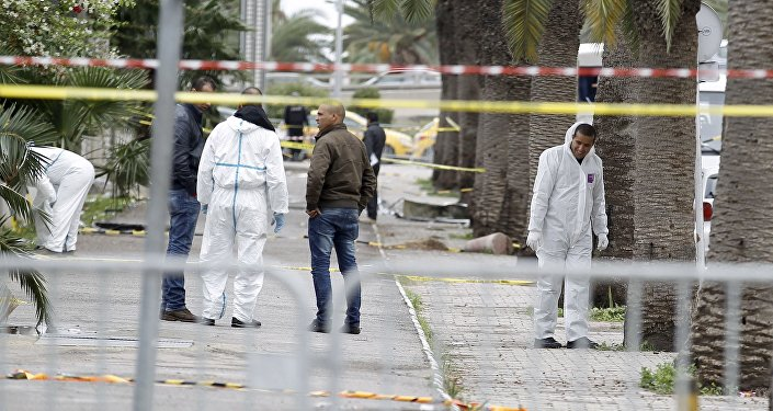 Tunisian forensics police inspect the scene of a suicide bomb attack in Tunis, Tunisia November 25, 2015.