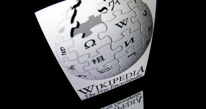 The Wikipedia logo is seen on a tablet screen on December 4, 2012 in Paris