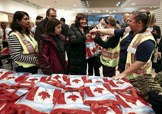 arrivée au Canada du premier groupe de réfugiés syriens