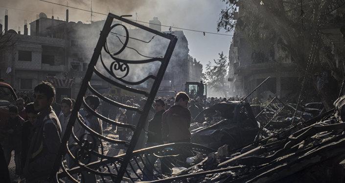 résidents de Homs, site de l'attentat terroriste dans le centre-ville