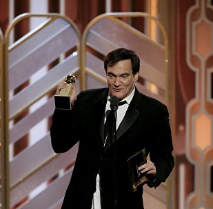 Quentin Tarantino accepts the award for Ennio Morricone after The Hateful Eight won Best Original Score - Motion Picture at the 73rd Golden Globe Awards in Beverly Hills, California January 10, 2016