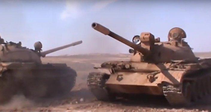 L'armée d'Assad attaque la capitale de Daech