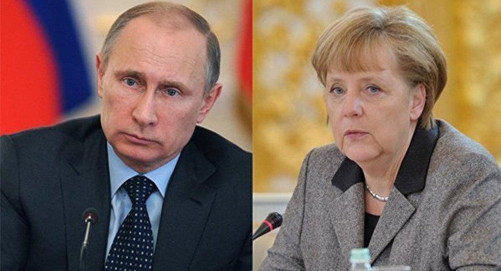 Ukraine: Poutine et Merkel prônent le dialogue entre Kiev et les régions