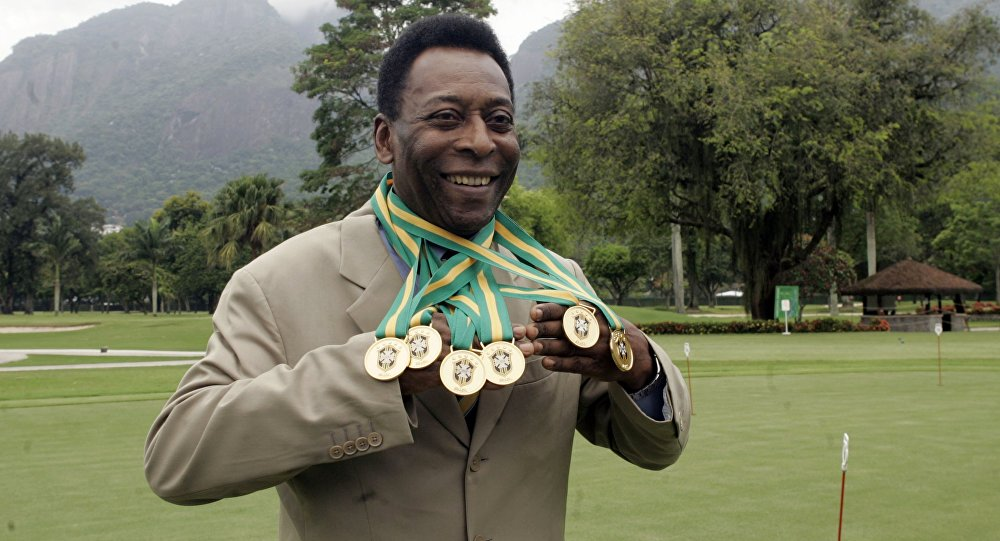Brazilian football legend Edson Arantes do Nascimento, known as 'Pele', poses with his six Brazil's champion medals on December 22, 2010 during a ceremony in Rio de Janeiro, Brazil.