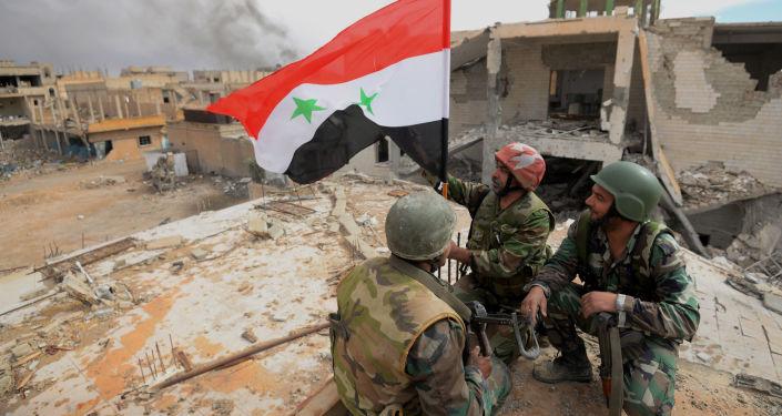 Des soldats de l'armée syrienne à Palmyre