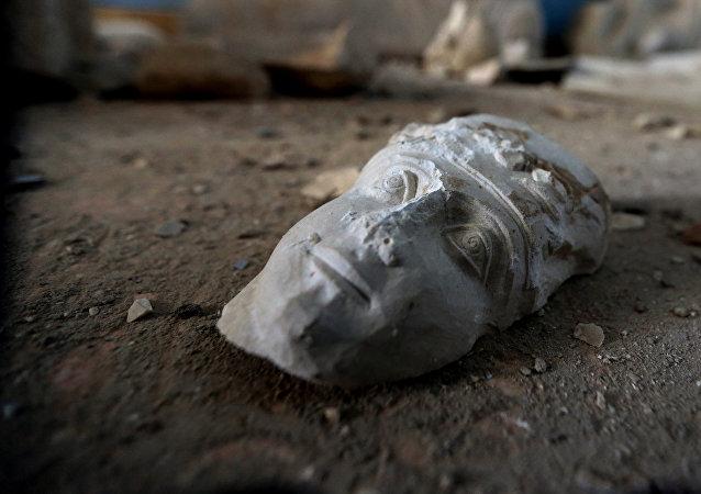 Ruines d'une statue dans le musée de Palmyre