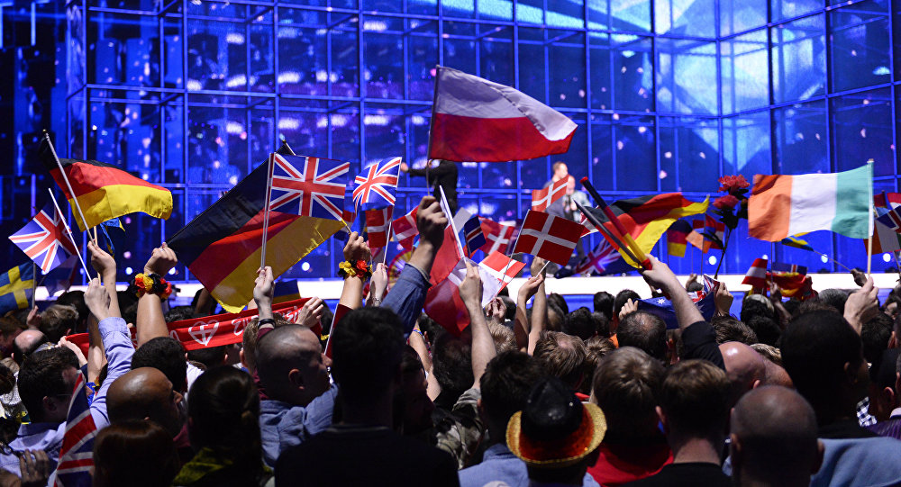 Supporters wave flags ahead of the Eurovision Song Contest 2014 Grand Final in Copenhagen, Denmark, on May 10, 2014