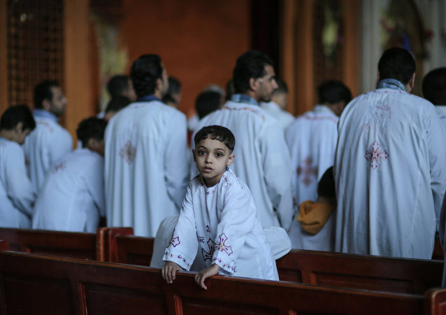 Egyptian Orthodox Christians celebrate Palm Sunday at the Samaan el-Kharaz Church in the Mokattam district of Cairo, Egypt, Sunday, April 5, 2015.