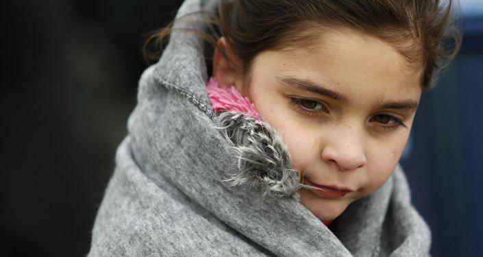 Une fille migrant