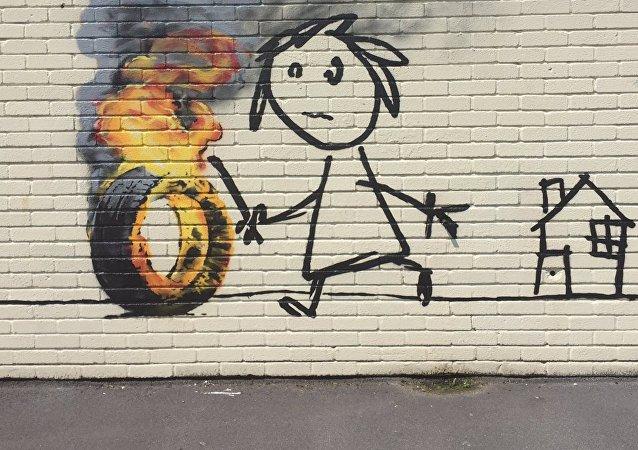 Le peinture de Banksy sur un mur d'une école primaire de Bristol