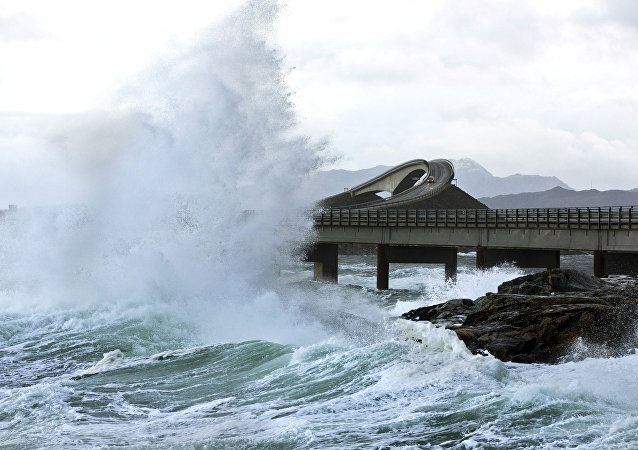 A picture taken on November 26, 2011 shows a giant wave over the Atlantic Road in Averøy, Norway as the storm Berit struck the Norwegian coast.