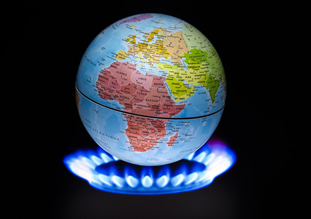 A picture taken on November 4, 2015 shows a small globe above a fire to illustrate global warming