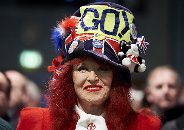 A pro-Brexit campaigner smiles at a public meeting by pro-Brexit campaigners central London on February 19, 2016.