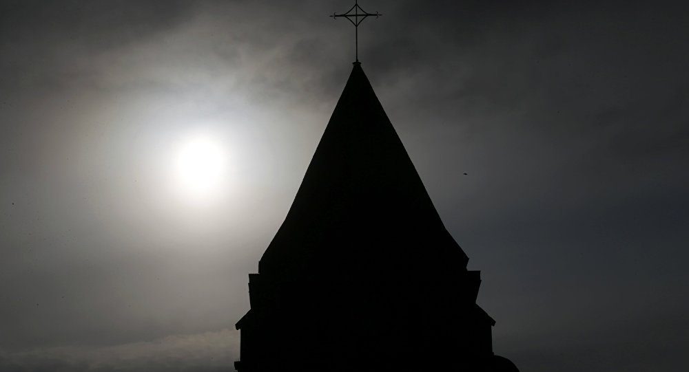 A view shows the bell tower of the church in Saint-Etienne-du-Rouvray near Rouen in Normandy, France, where French priest, Father Jacques Hamel, was killed with a knife and another hostage seriously wounded in an attack on the church that was carried out by assailants linked to Islamic State, July 27, 2016.