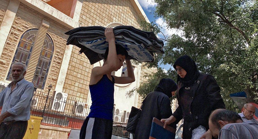Dans le centre d'Alep, la vie continue