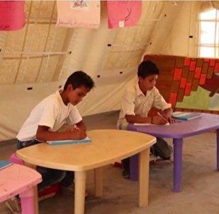 Ecole dans un camp des réfugiés