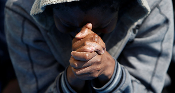 A migrant prays on the Migrant Offshore Aid Station (MOAS) ship Topaz Responder after being rescued around 20 nautical miles off the coast of Libya, June 23, 2016.