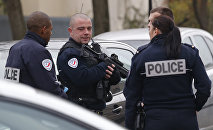 Police officers patrol near a pre-school in Paris suburb Aubervilliers on Monday, Dec.14, 2015.