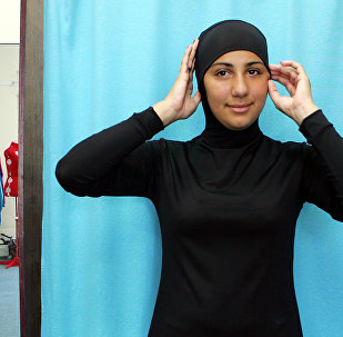 Muslimin in einem Burkini
