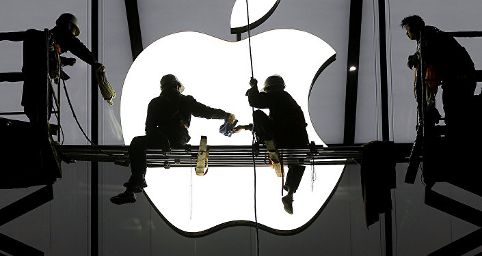 Workers prepare for the opening of an Apple store in Hangzhou, Zhejiang province