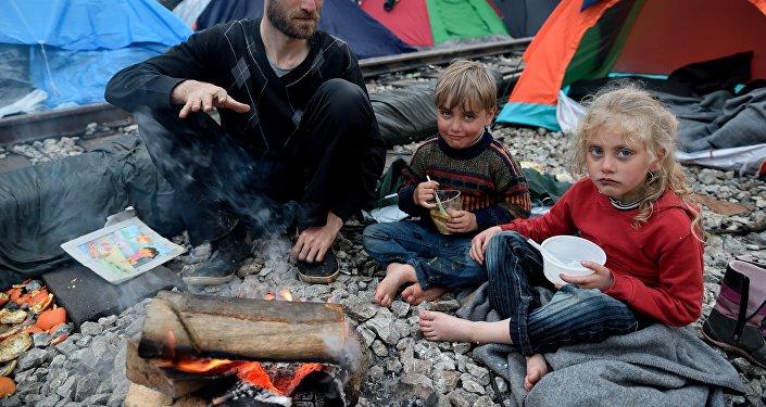 Un père syrien et  ses  deux enfants