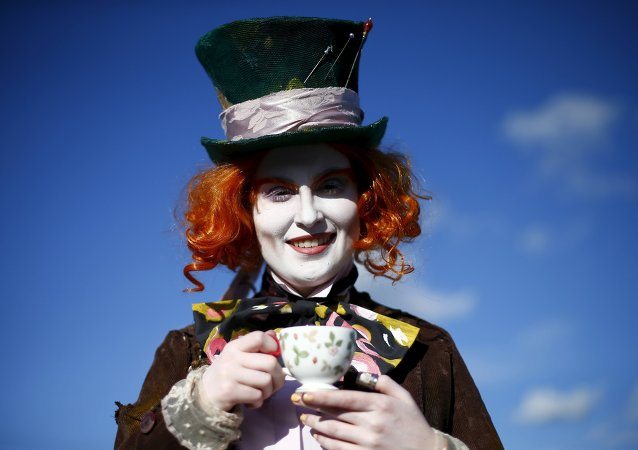 Ella poses as the Mad Hatter from Alice in Wonderland, outside the MCM Comic Con at the Excel Centre in East London, Britain, in this October 25, 2014 file photo