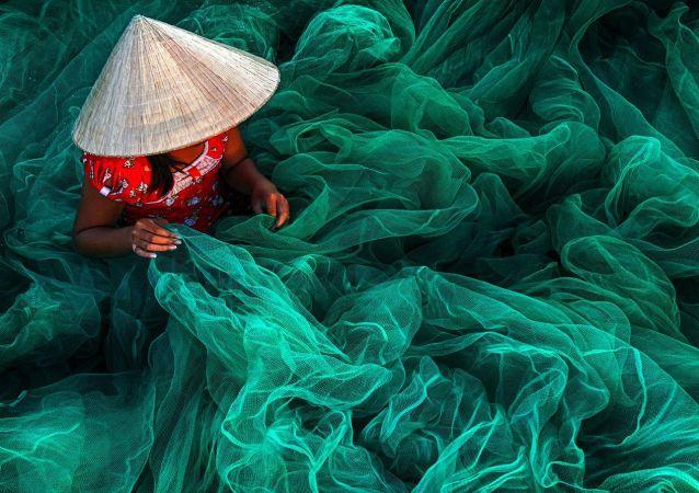 Фотография Phan Rang Fishing Net Making вьетнамского фотографа Danny Yen Sin Wong